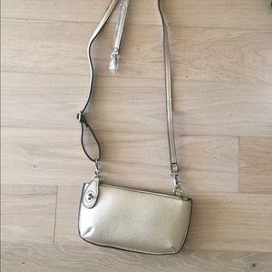 Crossbody gold bag with wristlet strap